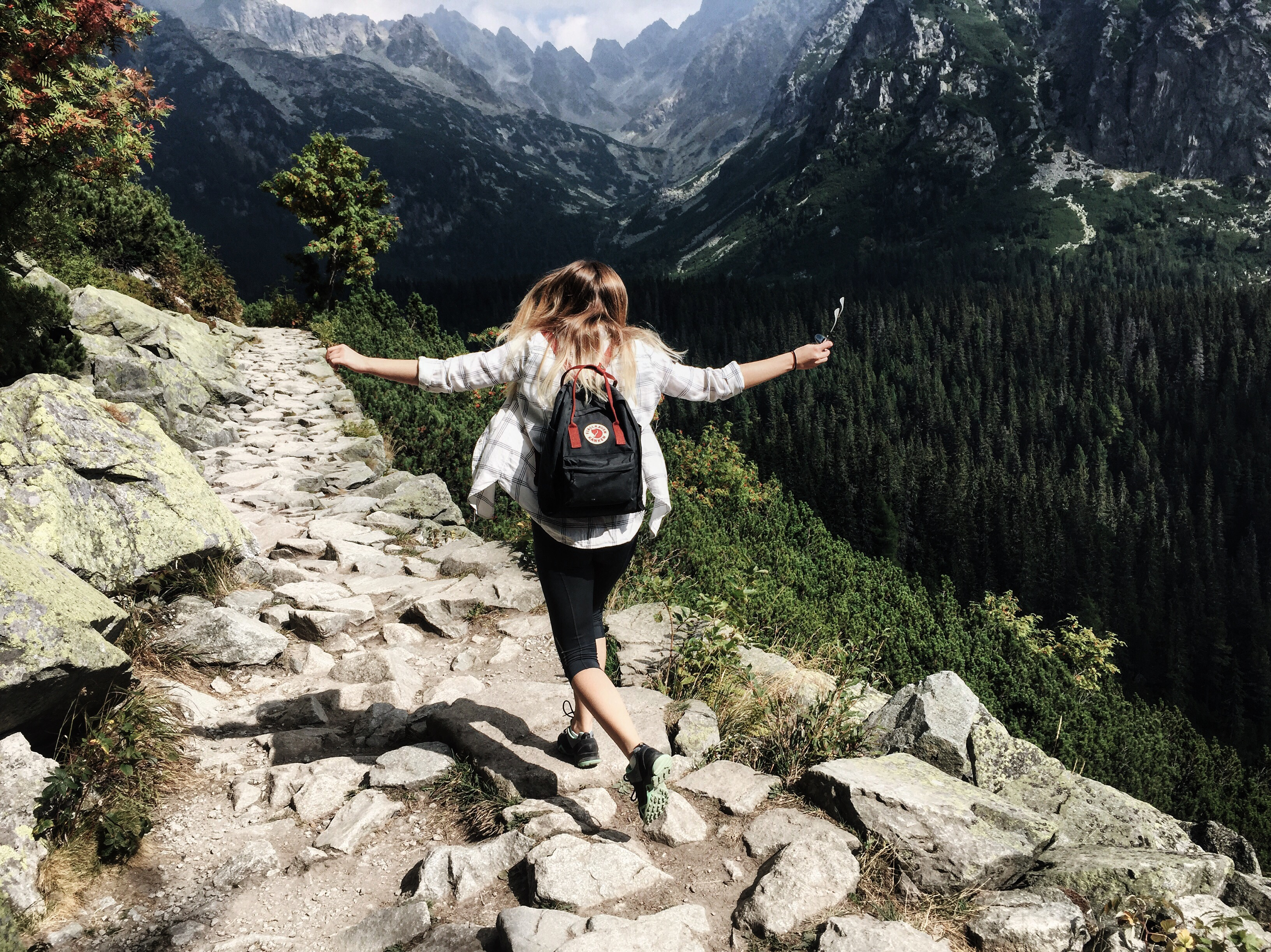 Image of a girl trekking on rocky ground