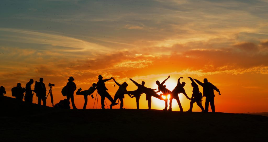 Image of a group of friends watching the sunset