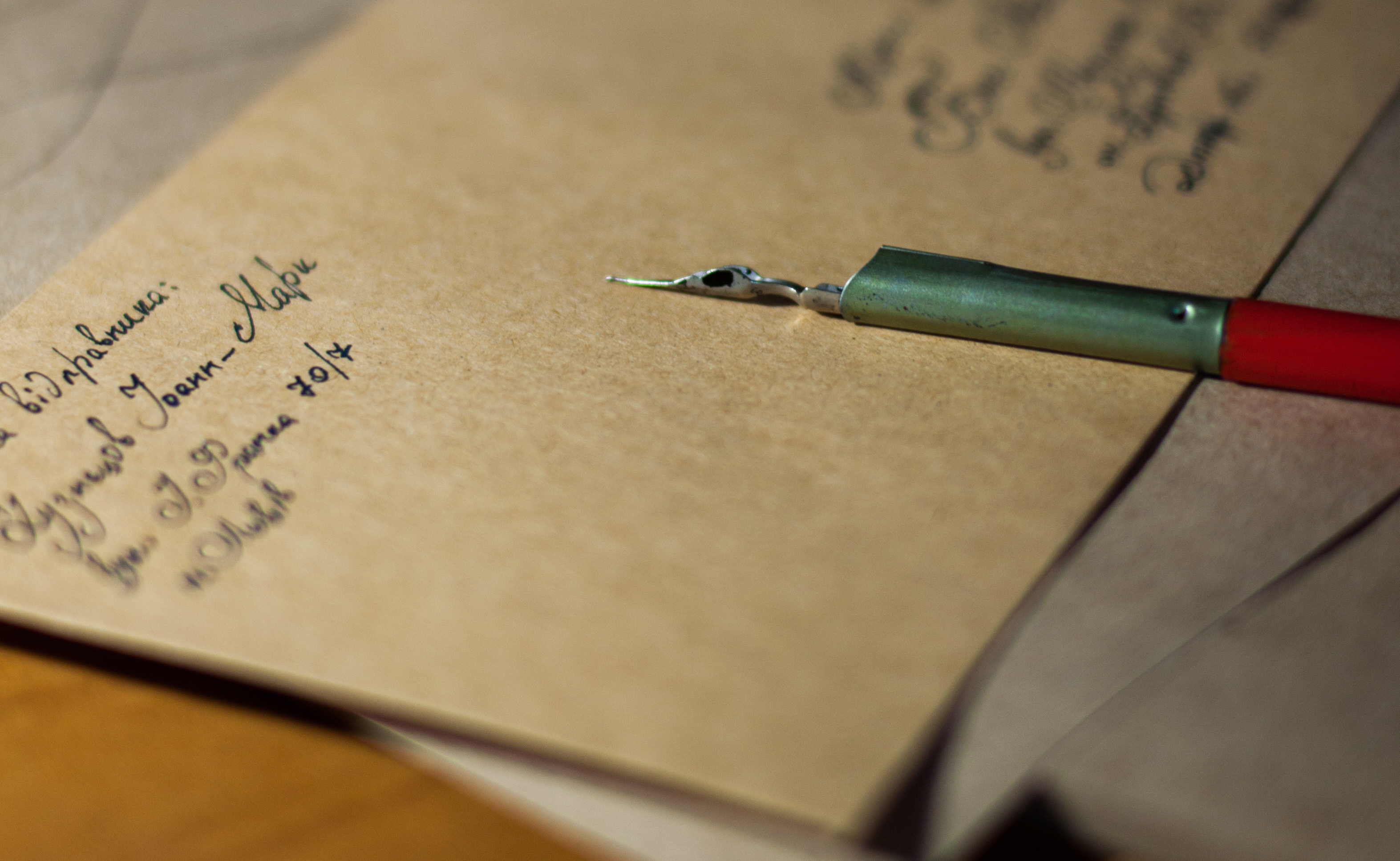Image of a letter and a pen