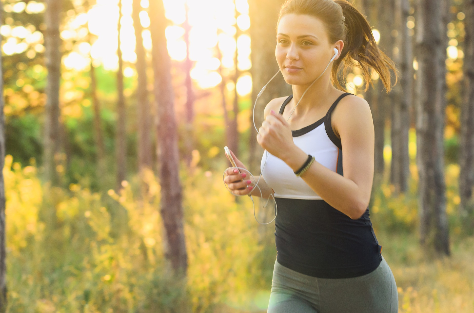 Picture of a woman running with earphones