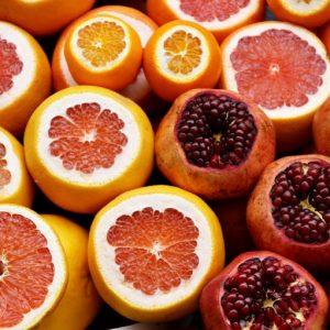 Citrus fruits, pomegranates, tropical fruits, freshly sliced